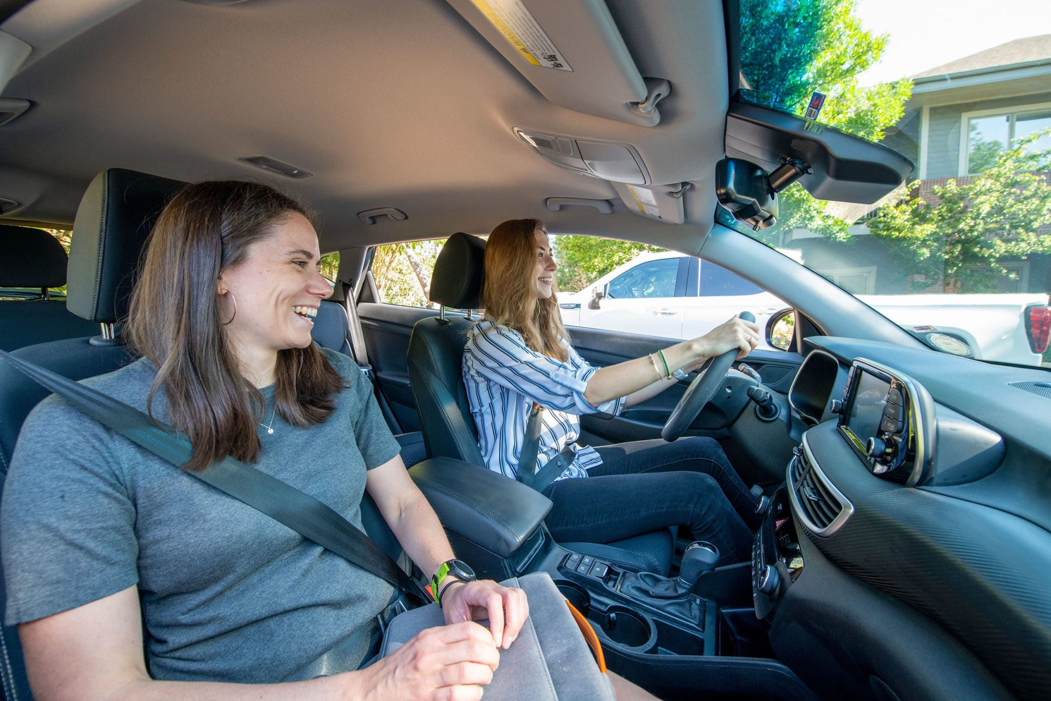 Two girls carpool to work together